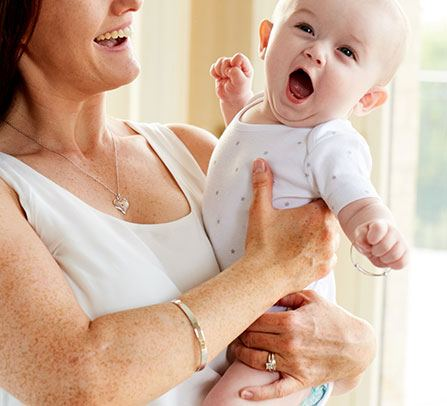 mum and baby yawning