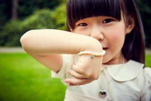 young girl with pearl bracelet
