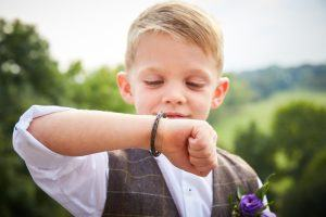 young boy with leather bracelet