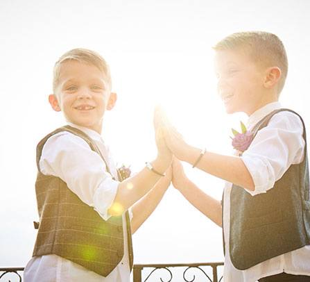 boys at wedding with leather bracelets