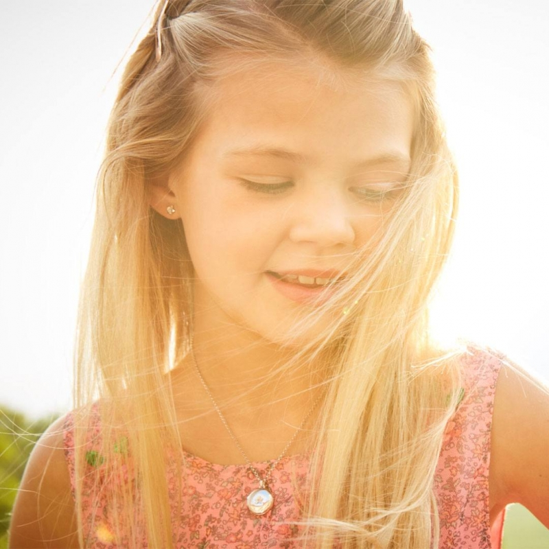 young girl with silver locket