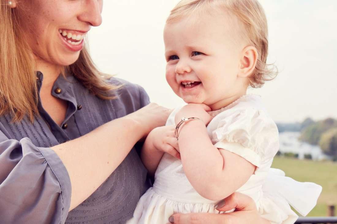 mum and baby smiling