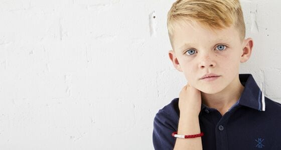 child with leather bracelet
