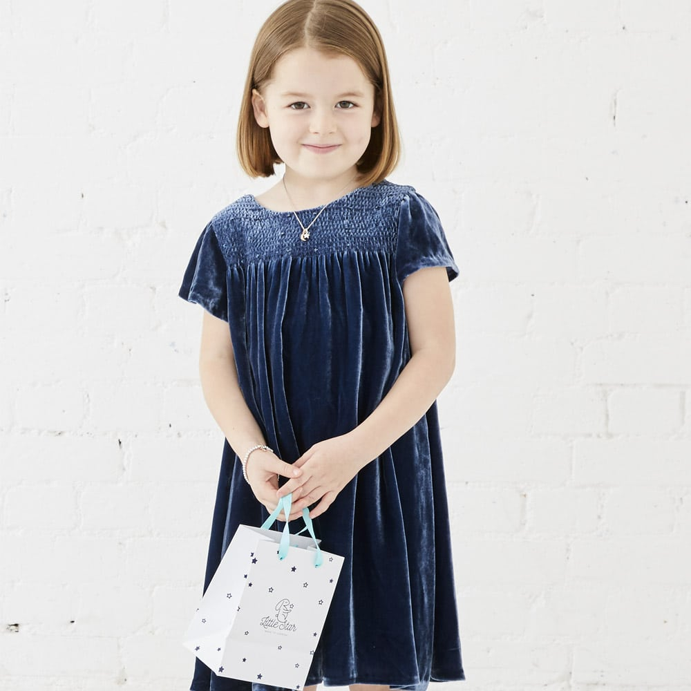 young girl with little star jewellery bag