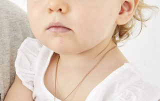 young girl with star necklace