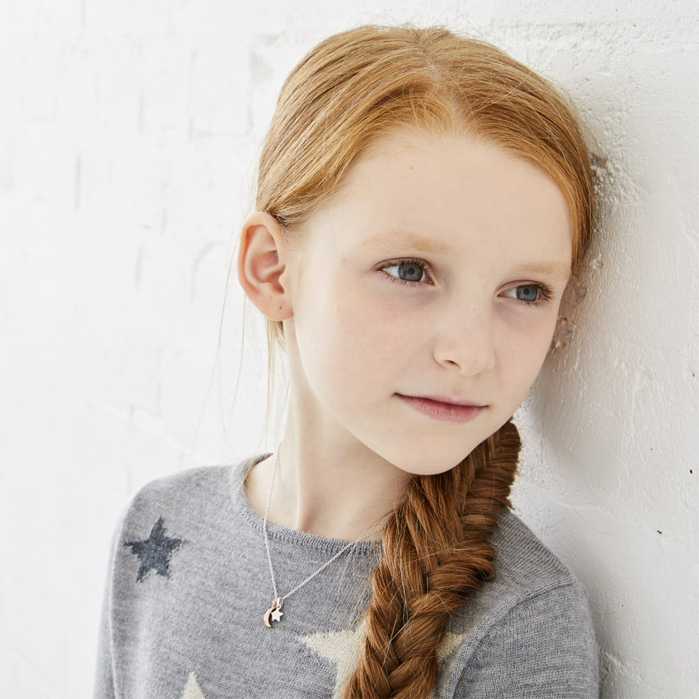 young girl with necklace
