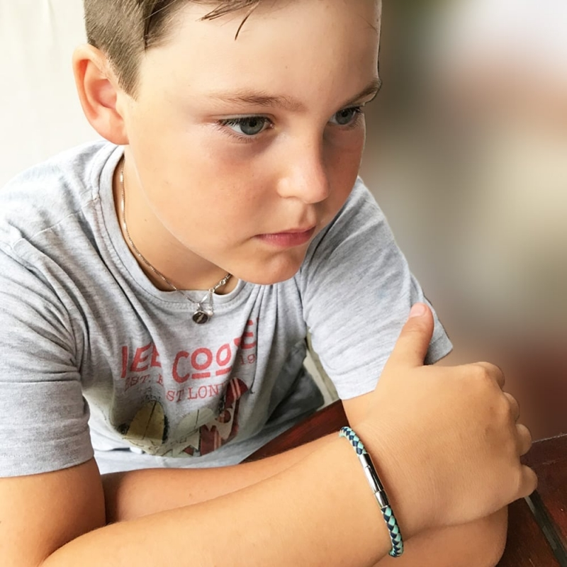 young boy with bracelet