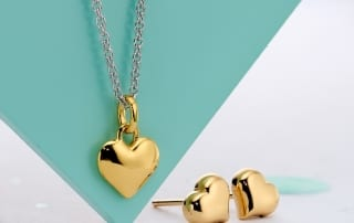 gold heart necklace and earrings