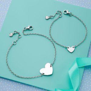 two silver heart bracelets