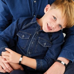 child in denim with dad and matching bracelet