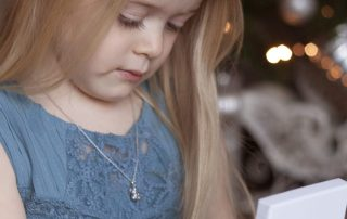 little girl with little star necklace