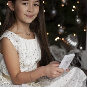 child with little star gift packaging
