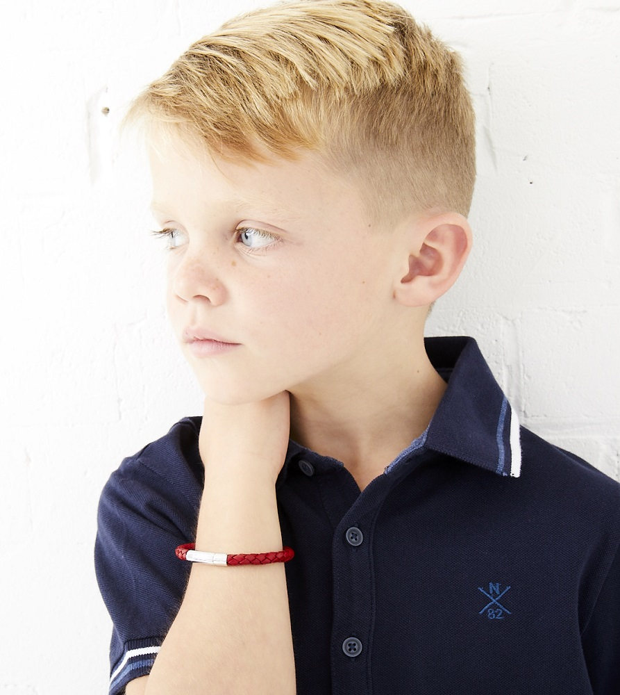 little boy with red leather bracelet