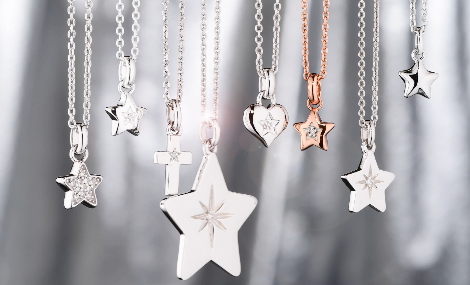 A group of hanging star necklaces
